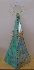 This stained glass girl is over 2 feet tall. She makes a great show-me piece for a market booth.