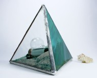 """These large 6"""" (15 cm) size paperweights are perfect for a desk or living room table. This one in teal features several ocean-related charms and other items."""